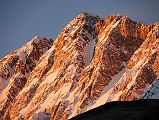 The Shishapangma Southwest Face burns orange at sunset from Shishapangma Southwest Advanced Base Camp (5276m).
